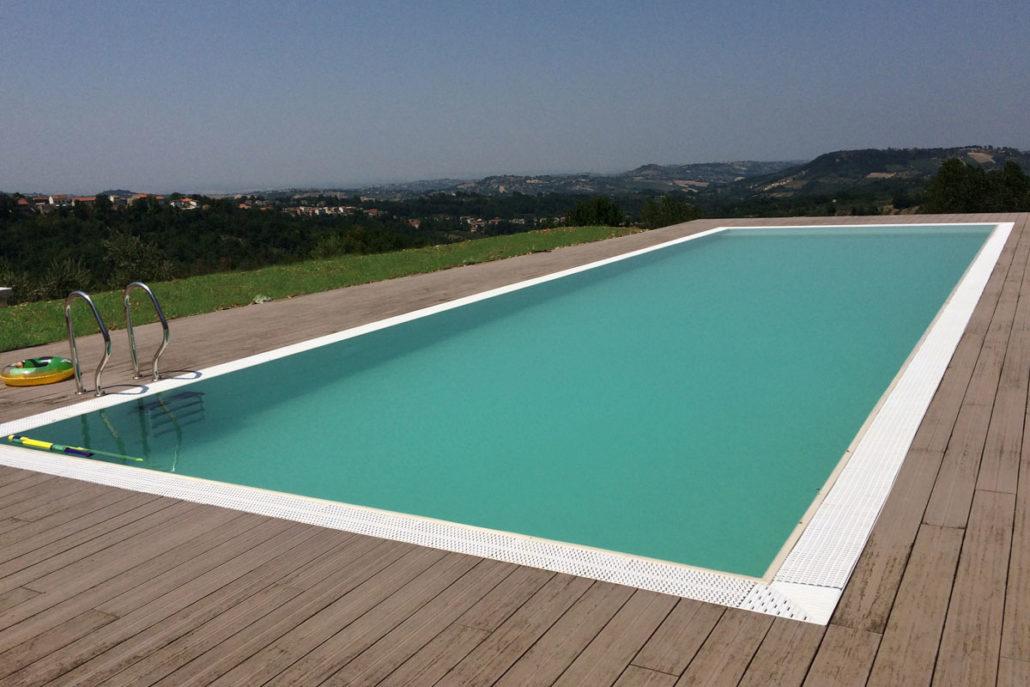 Piscine a sfioro cobel legno e piscine for Piscina le grazie